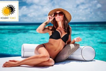 Glamorous woman in bikini and sunglasses, lyingposing in bikini by pool