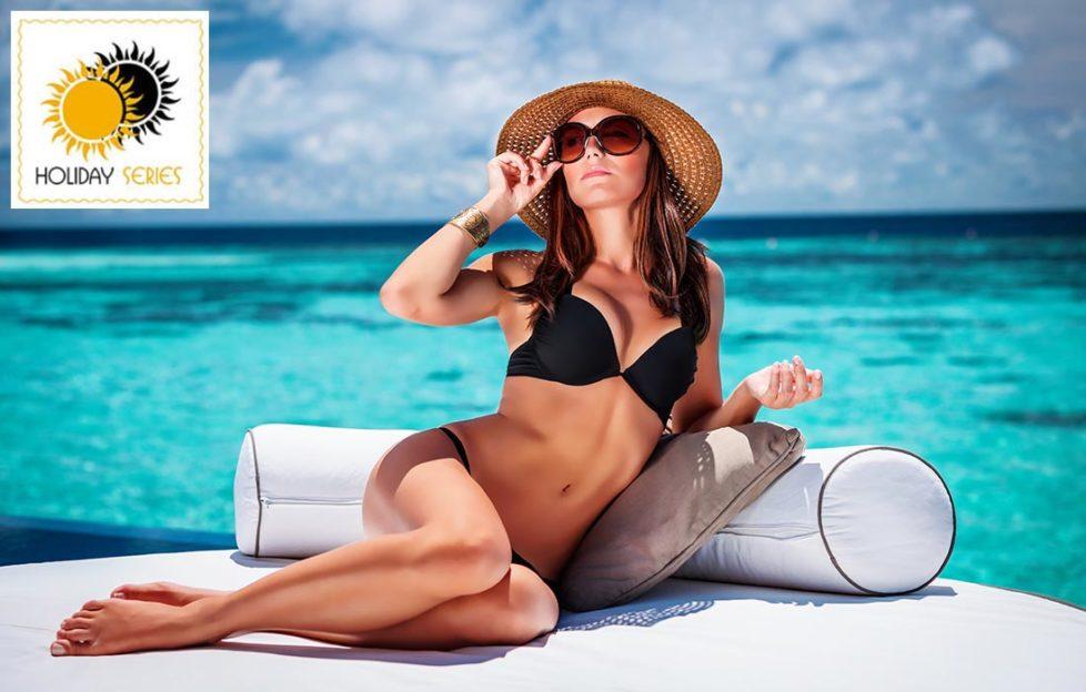 Glamorous woman in bikini and sunglasses, lyingposing in bikini by pool