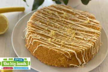 Sponge cake with zigzag drizzled icing and lemon zest