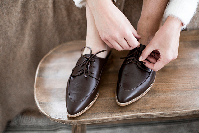 A lady trying on leather shoes Pic: Shutterstock