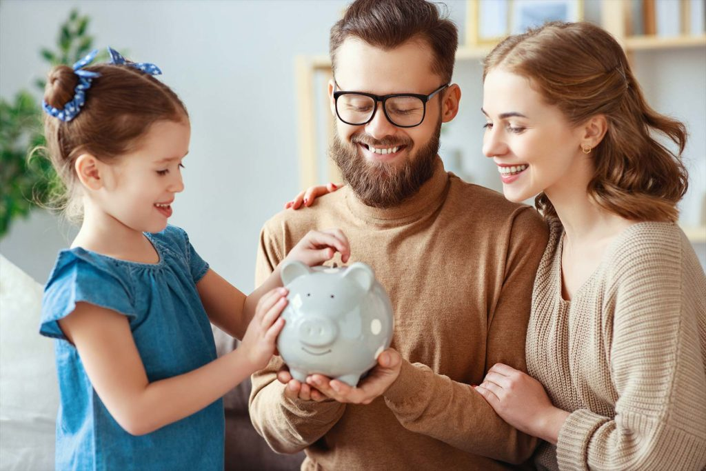 family savings, budget planning, children's pocket money. family with piggy Bank moneybox