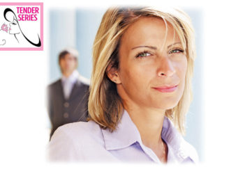 Tense woman looks at camera, young man blurred behind her