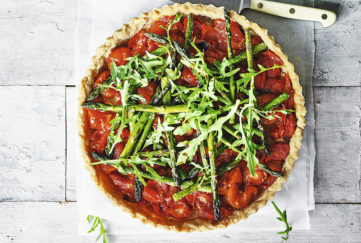 Shortcrust pastry tart, rich confit tomato filling, charred asparagus on top and fresh rocket leaves
