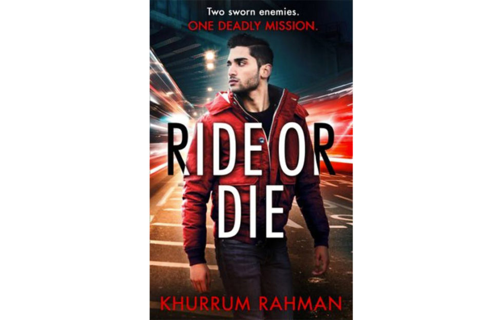 Cover of Ride Or Die thriller, handsome young Asian man in red jacket over black clothes looking over his shoulder, lights of traffic at night