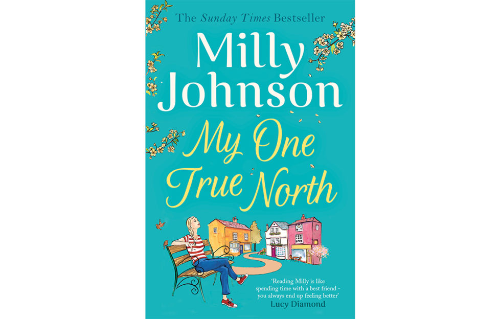 cover of my one true north, happy young woman sitting on bench in village