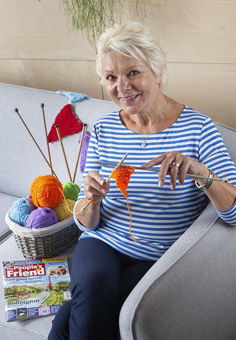 Lady knitting bunting