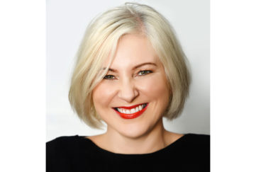 Author Anna McPartlin, smiling woman with red lipstick, blonde bob and black top