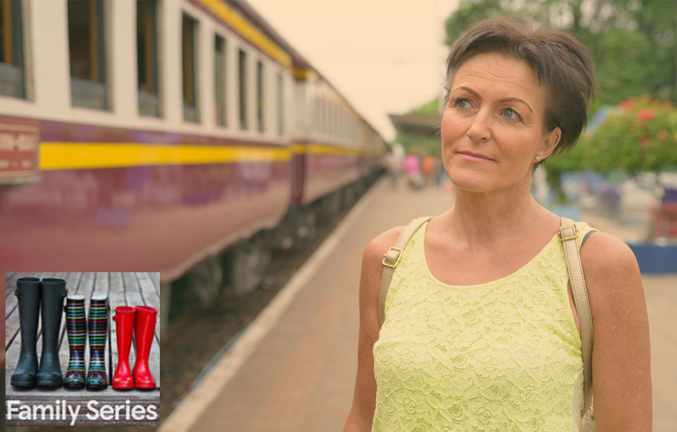 Empty nest. Woman in her 50s looking sad as train leaves
