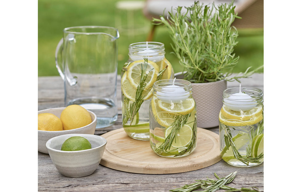 Jars with rosemary, citrus fruit and oils