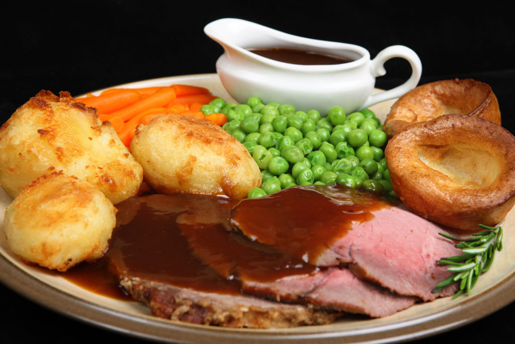 British roast beef dinner with Yorkshire puddings.;