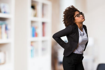 business black woman having a back ache;