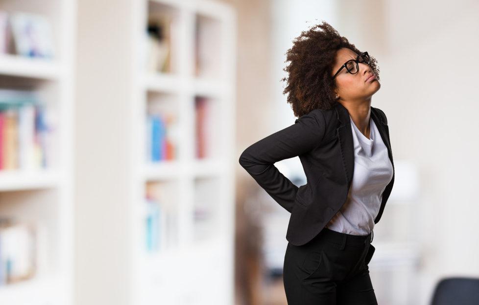 business black woman having a back ache;