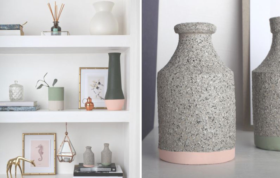 A selection of stone vases on a shelf