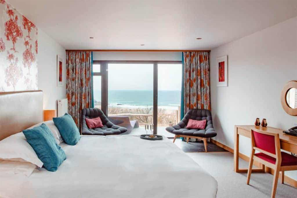 View through hotel room to sliding glass doors and view of the beach