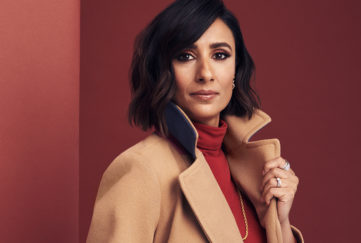 Anita Rani inmodels camel coat and red roll neck top