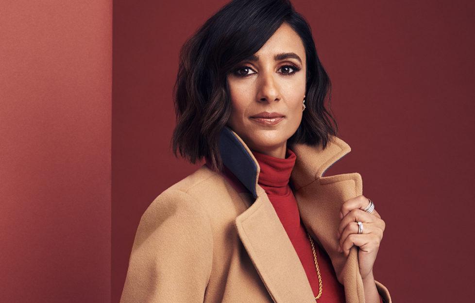 Anita Rani inmodels camel coat and red roll neck top