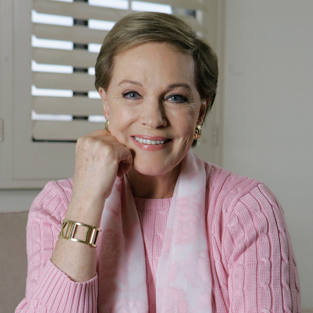 Dame Julie Andrews, in 2007, relaxed with chin on hand, smiling