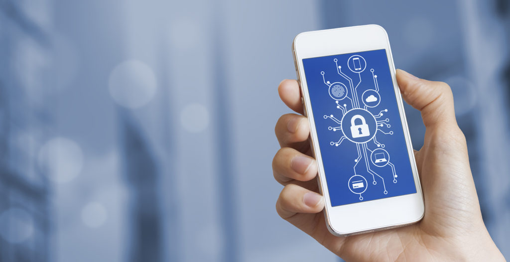Cybersecurity concept with a person showing smartphone screen with cyber security icons in the shape of a electronic microchip circuit board and blurred background