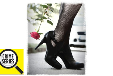 Woman in beautiful black high heeled shoes and black tights, trailing pink long stemmed rose, we only see shoes and lower legs