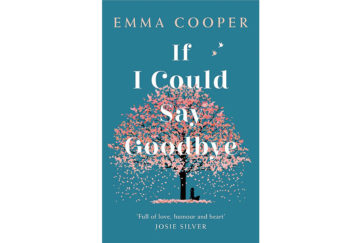 Cover of If I Could Say Goodbye. On a teal background, a woman sits under a cherry tree that is shedding its pink blossom