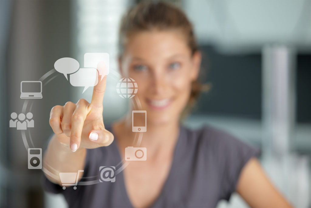 Smiling woman pressing touch screen on social network icon