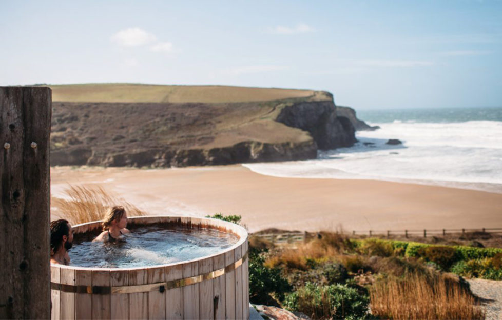 Couple in hot tub overlooking beach