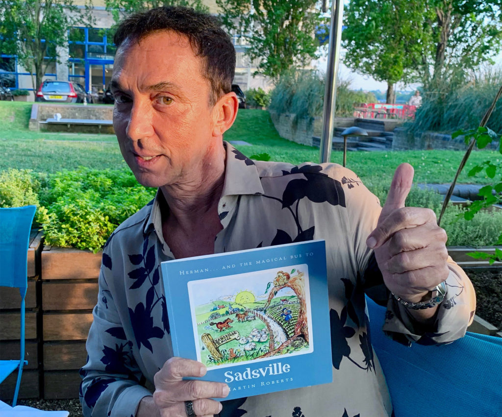Bruno Tonioli holding the book and giving a thumbs up
