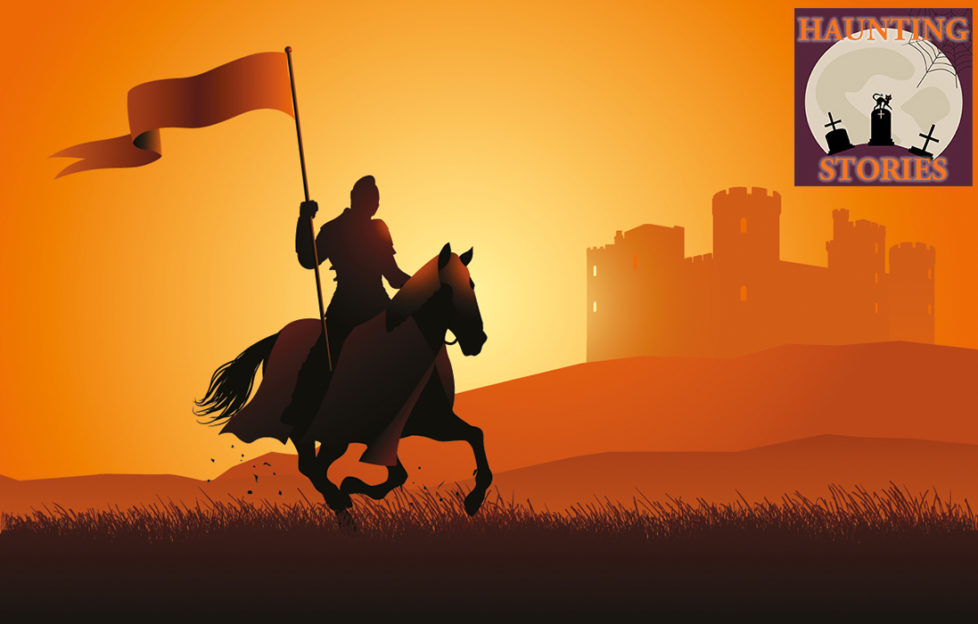 Silhouette of horseman with banner, riding past castle at sunset