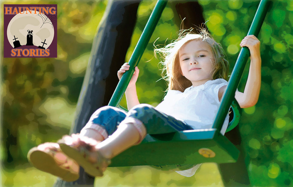 Girl aged 5 on swing, bushes behind