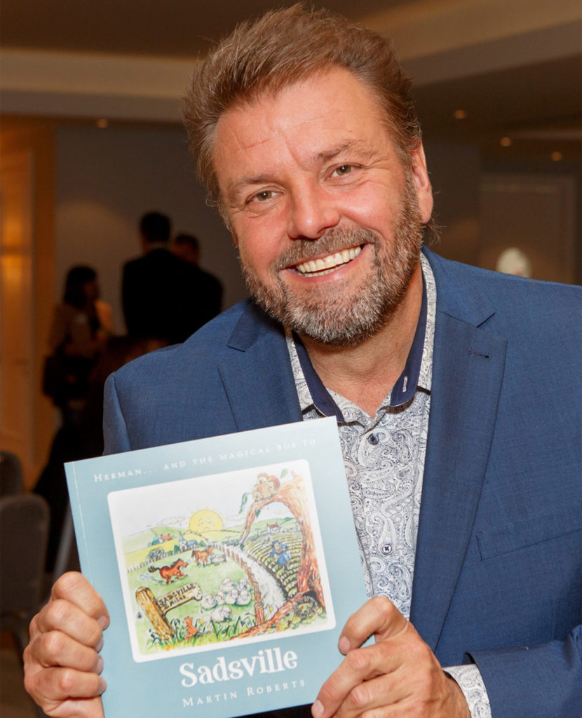 TV presenter and author Martin Roberts with his book Sadsville