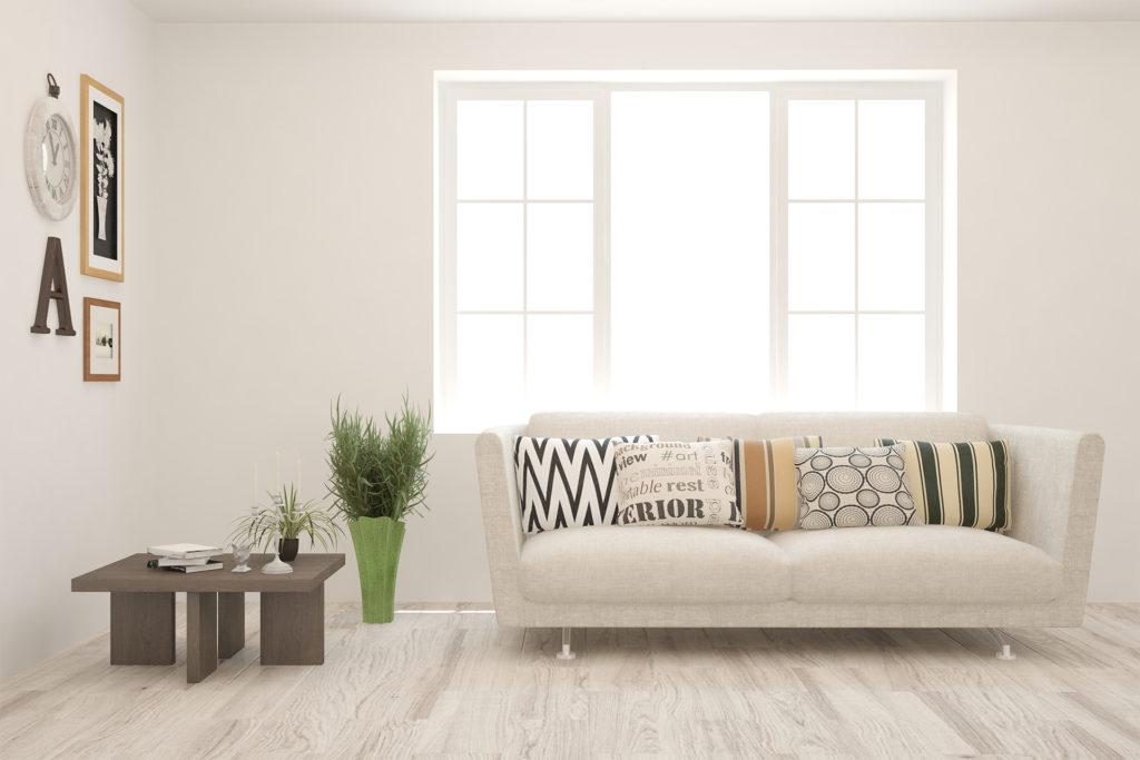White living room with sofa. Scandinavian interior design.