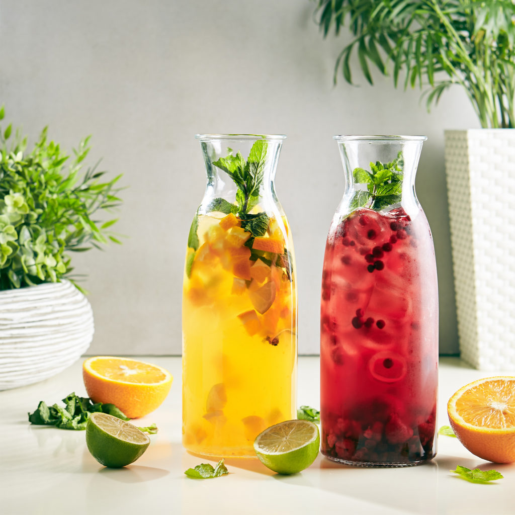 Fresh Homemade Berry and Citrus, Mint and Ice. Iced Tea, in Tall Bottles