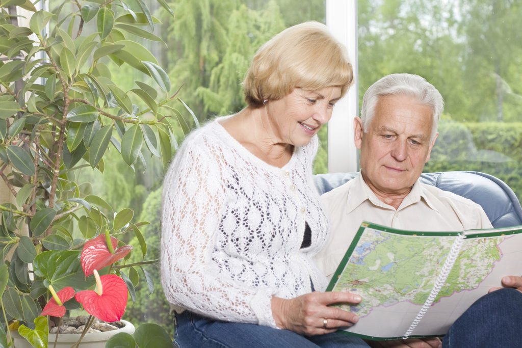 Romantic old couple planning a trip together