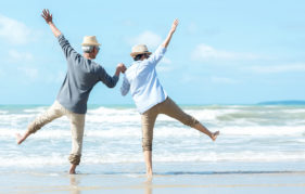 Asian Lifestyle senior couple jumping on the beach happy in love romantic and relax time. Tourism elderly family travel leisure and activity after retirement in vacations and summer.