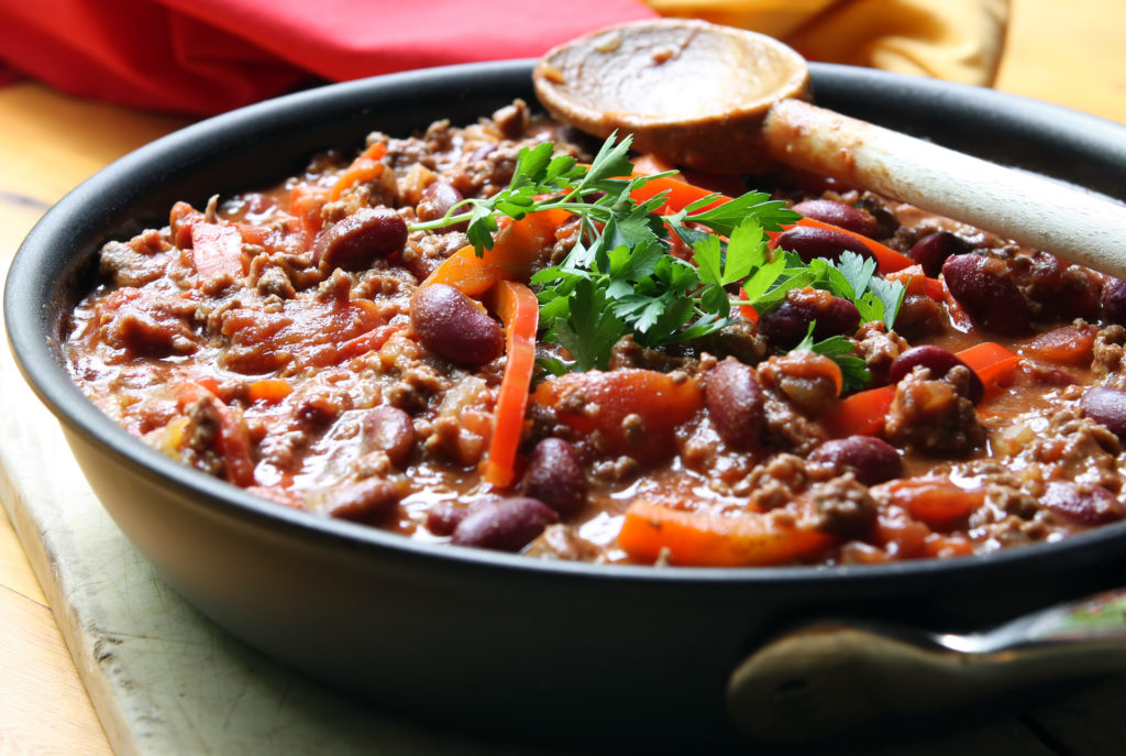 A pan of chilli, ready to serve. Soft focus, shallow depth of field.;