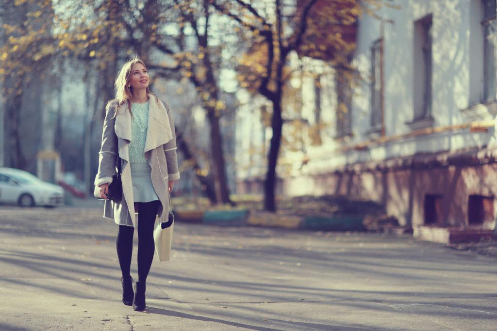 Autumn portrait of happy girl on a walk;