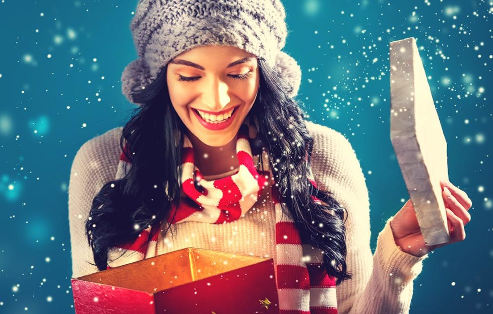 Lady opening Christmas gift Pic: Shutterstock