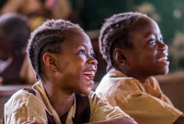 Smiling children in a class in Liberia Pic: Chris Watt