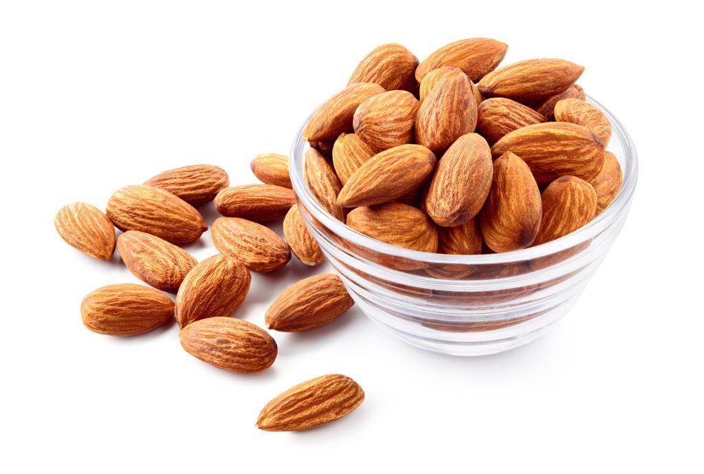 Almond. Almond nut isolated. Almond slice. Full depth of field.;