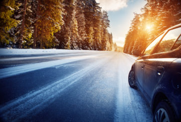 car on winter road in the morning;