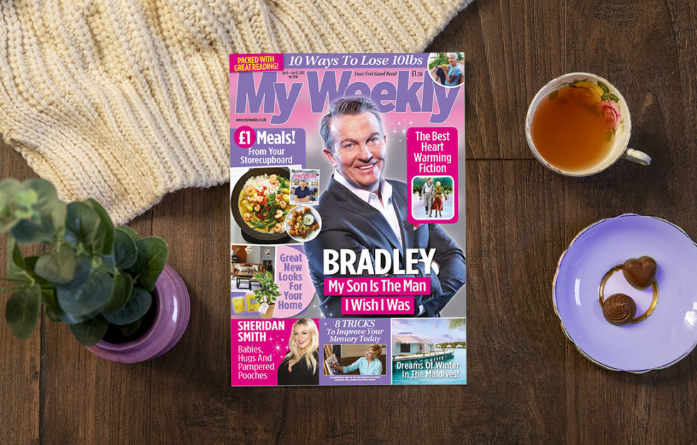 Lifestyle image on dark wooden floor including cover of My Weekly latest issue Jan 5 with Bradley Walsh and storecupboard £1 meals