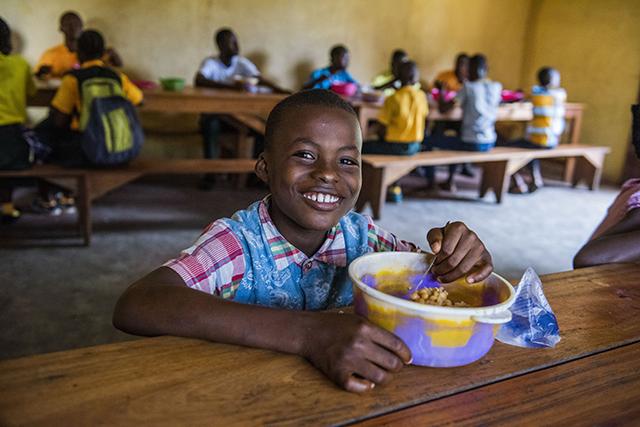Boy in Liberia receiving Mary's Meals Pic: Chris Watt
