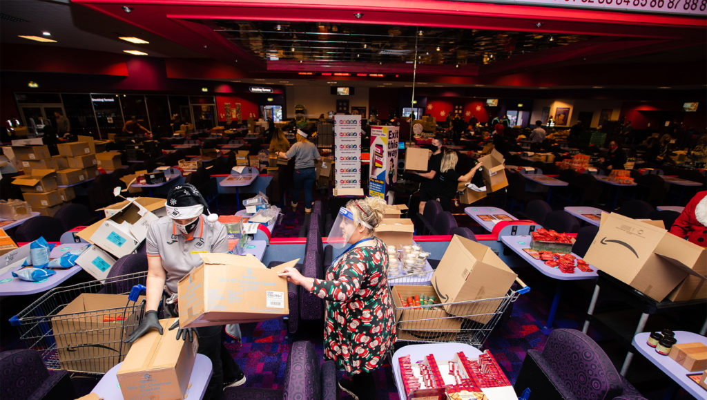 Bingo hall with boxes everywhere and s
