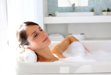 Beautiful woman relaxing in bathtub;