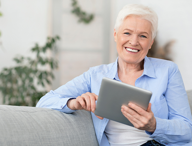Lady using tablet at home Pic: Shutterstock