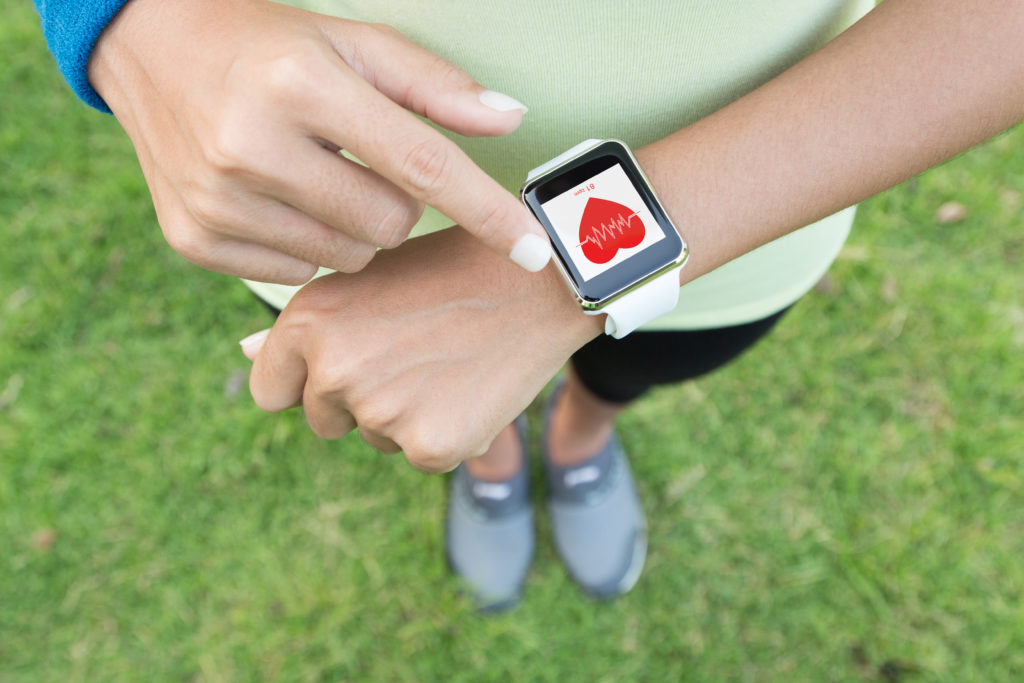 sport woman touch on hand watch health application ;