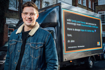 Dr Alex by the van billboard