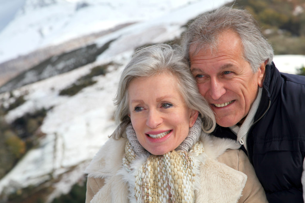 Portrait of happy senior couple at the mountain;