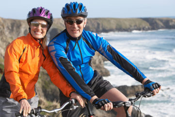 Couple cycling on coastline Pic: Shutterstock