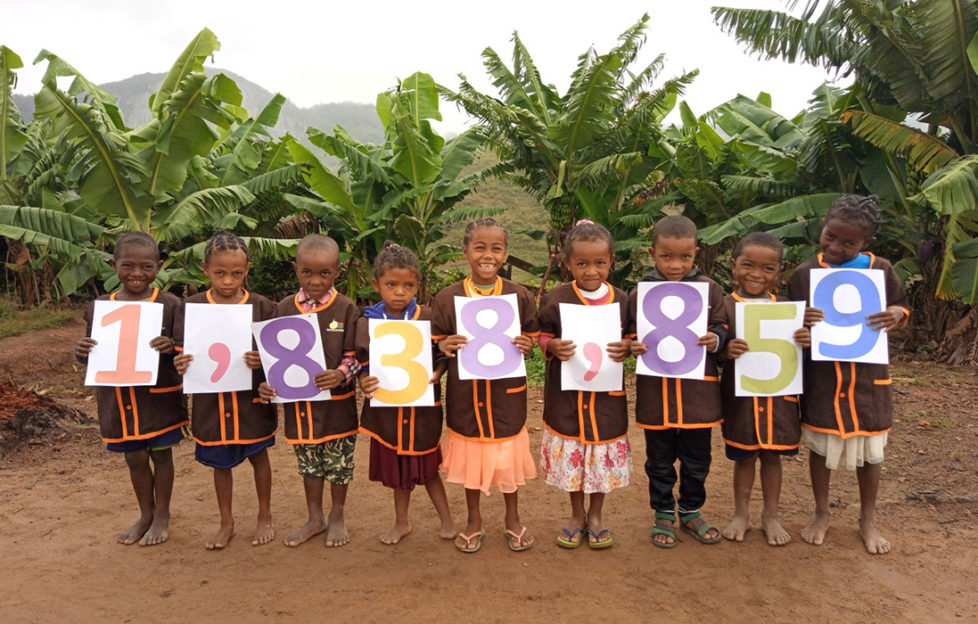 Children from Ankarinomby Primary School in Madagascar celebrate Mary's Meals feeding 1.8 million children